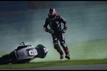 Broc parkes - MotoGP running after his bike 2014